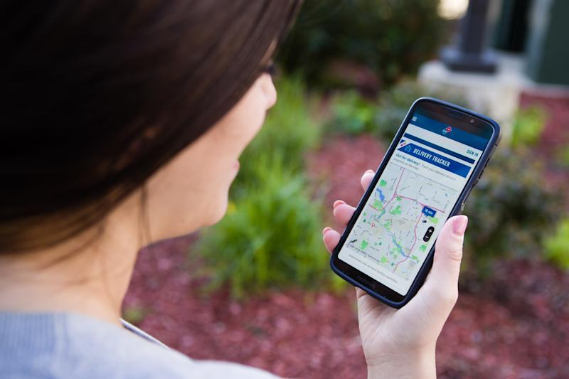 A woman uses the new Domino's GPS tracker.