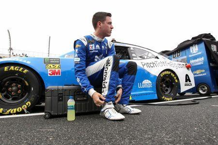 FILE PHOTO: May 5, 2019; Dover, DE, USA; NASCAR Cup Series driver Alex Bowman puts on his heat shields prior to the Gander RV 400 at Dover International Speedway. Matthew O'Haren-USA TODAY Sports