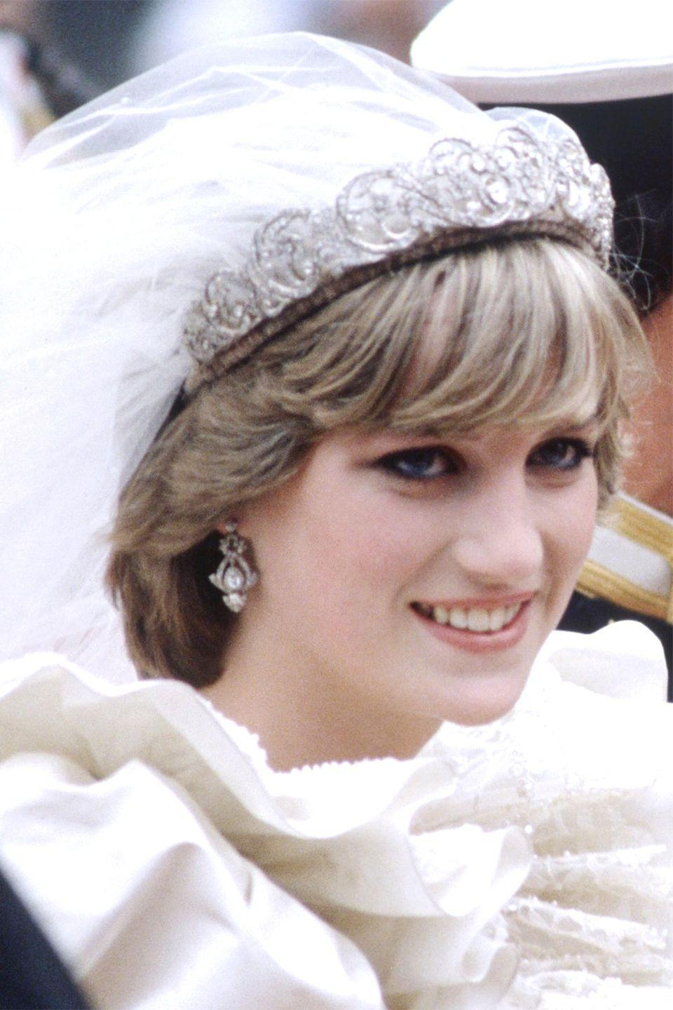 <p>For her wedding to Prince Charles, Diana sported more defined bangs while wearing a tiara and veil. </p>