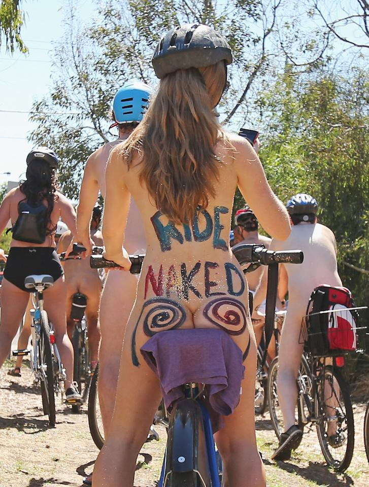 "MELBOURNE, AUSTRALIA - MARCH 03:  (EDITORS NOTE: IMAGE CONTAINS NUDITY) Naked cyclists take part in the World Naked Bike Ride on March 3, 2013 in Melbourne, Australia. The bike ride is intended to ""peacefully expose the vulnerability of cyclists, humanity and nature in the face of cars, aggression, consumerism and non-renewable energy"".  (Photo by Scott Barbour/Getty Images)"