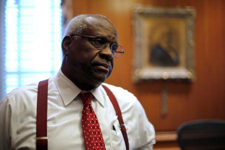 FILE PHOTO: U.S. Supreme Court Justice Clarence Thomas is seen in his chambers at the U.S. Supreme Court building in Washington, U.S. June 6, 2016. REUTERS/Jonathan Ernst/File Photo