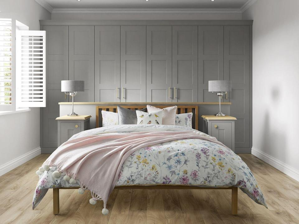 """<p>Whatever your interior style, pink and grey bedrooms are perfect for all. If you're not feeling bold enough to dabble in pink paint, why not paint your wall (or wardrobe doors) grey instead. Finish off the look with pink soft furnishings, whether it's cushions or a throw, and you'll have the ultimate relaxed retreat. </p><p><strong>•</strong> Laura Ashley fitted bedroom by <a href=""""https://www.symphony-group.co.uk/brands/urbano-bedrooms/"""" rel=""""nofollow noopener"""" target=""""_blank"""" data-ylk=""""slk:Symphony"""" class=""""link rapid-noclick-resp"""">Symphony</a> in Marston Cobble Grey </p>"""