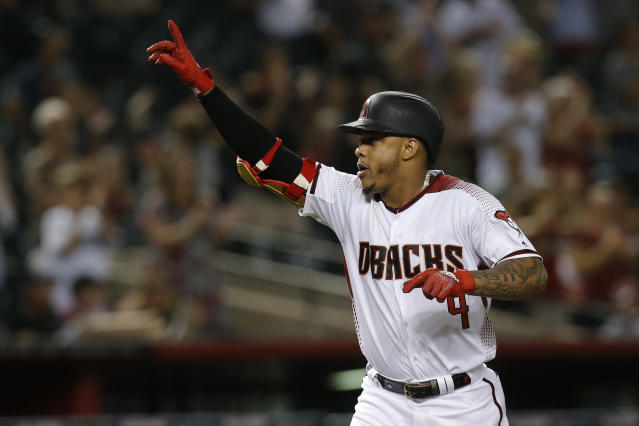 Arizona Diamondbacks' Ketel Marte reacts after hitting a two-run home run against the Colorado Rockies in the sixth inning of a baseball game Monday, Aug. 19, 2019, in Phoenix. (AP Photo/Rick Scuteri)