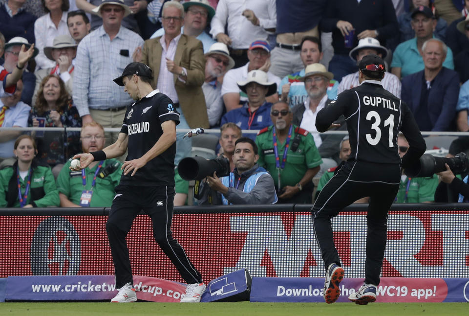 Trent Boult catches England's Ben Stokes but steps on the boundary rope to concede 6 runs (AP Photo/Matt Dunham)