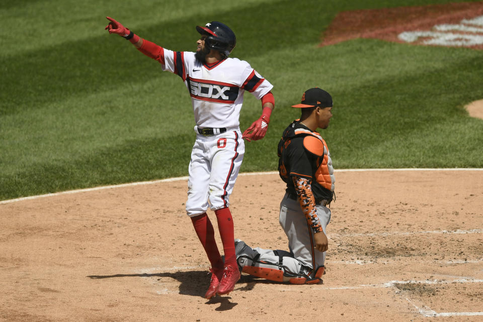 Chicago White Sox's Billy Hamilton, left, celebrates at home plate after hitting a solo home run during the third inning of a baseball game against the Baltimore Orioles, Sunday, May 30, 2021, in Chicago. (AP Photo/Paul Beaty)