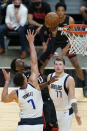 Miami Heat center Bam Adebayo (13) goes up for a shot against Dallas Mavericks center Dwight Powell (7) and guard Luka Doncic (77) during the second half of an NBA basketball game, Tuesday, May 4, 2021, in Miami. (AP Photo/Wilfredo Lee)