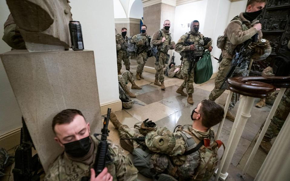 Members of the National Guard try to get some sleep inside the US Capitol - JIM LO SCALZO/EPA-EFE/Shutterstock/Shutterstock
