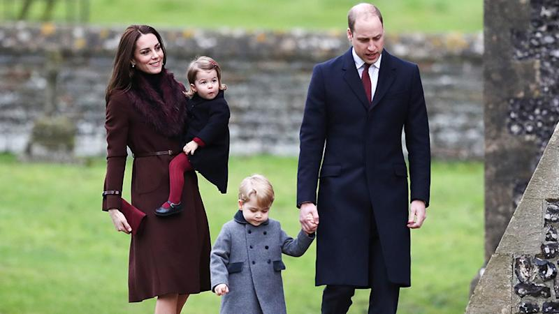 Kate Middleton hold Charlotte while Prince William holds Prince George's hand at Sandringham.