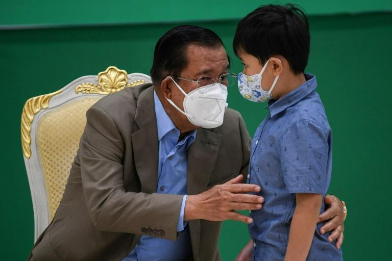 Hun Sen has dismissed safety concerns over vaccinating younger children (AFP/TANG CHHIN Sothy)