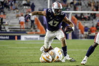 Auburn tight end John Samuel Shenker (47) is tackled by Tennessee defensive back Theo Jackson (26) after a reception during the second half of an NCAA college football game Saturday, Nov. 21, 2020, in Auburn, Ala. (AP Photo/Butch Dill)