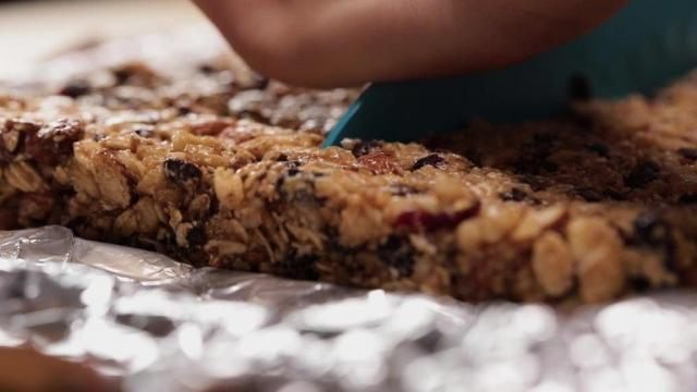Cutting granola bars with a knife