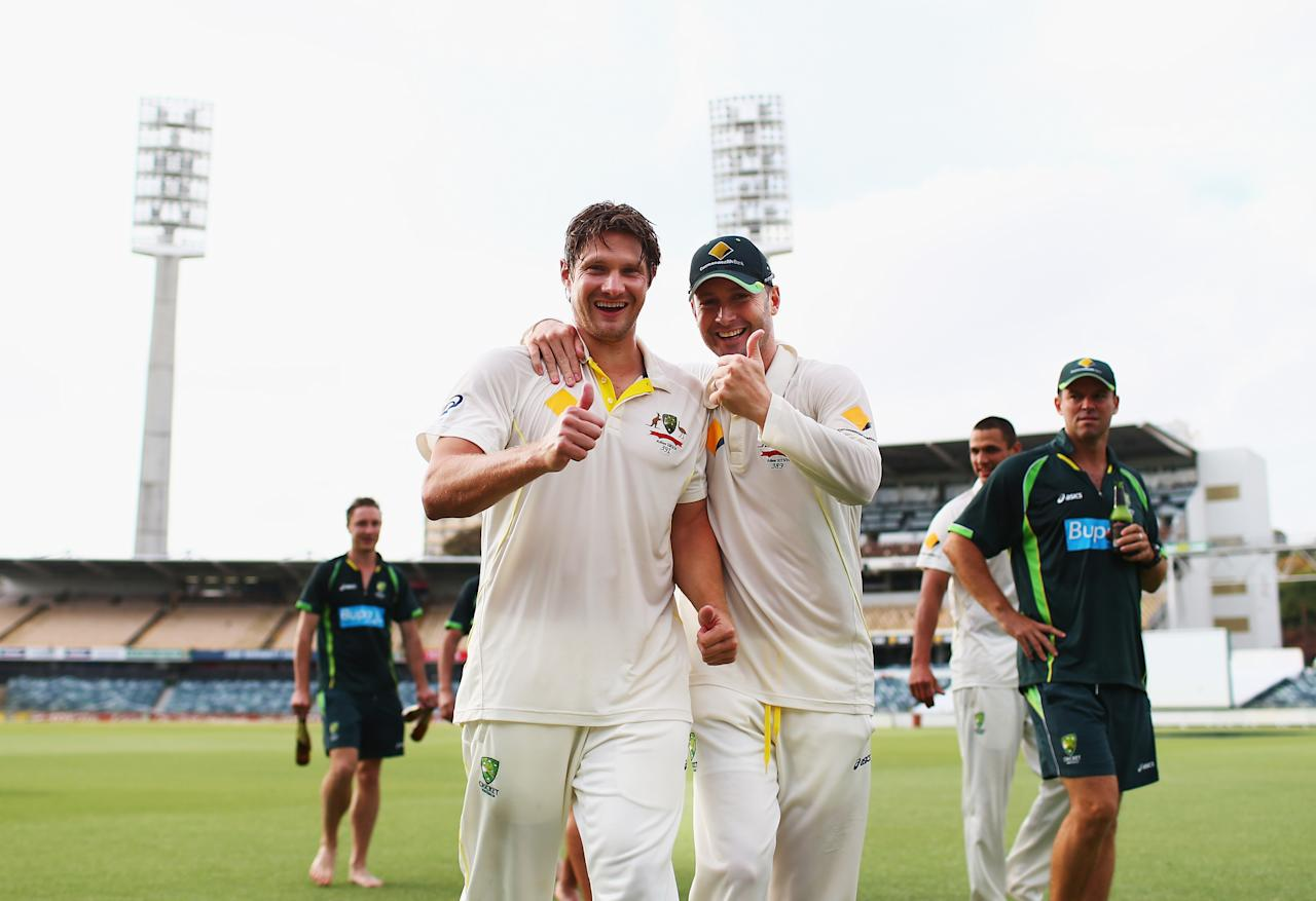 PERTH, AUSTRALIA - DECEMBER 17:  Michael Clarke and Shane Watson of Australia celebrate on the pitch after day five of the Third Ashes Test Match between Australia and England at WACA on December 17, 2013 in Perth, Australia.  (Photo by Ryan Pierse/Getty Images)