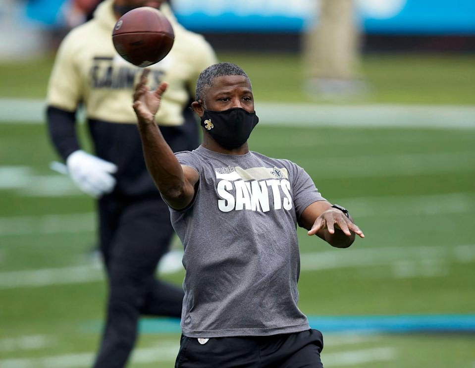 New Orleans Saints secondary coach Aaron Glenn throws prior to an NFL game against the Carolina Panthers in Charlotte, N.C. on Jan. 3, 2021.