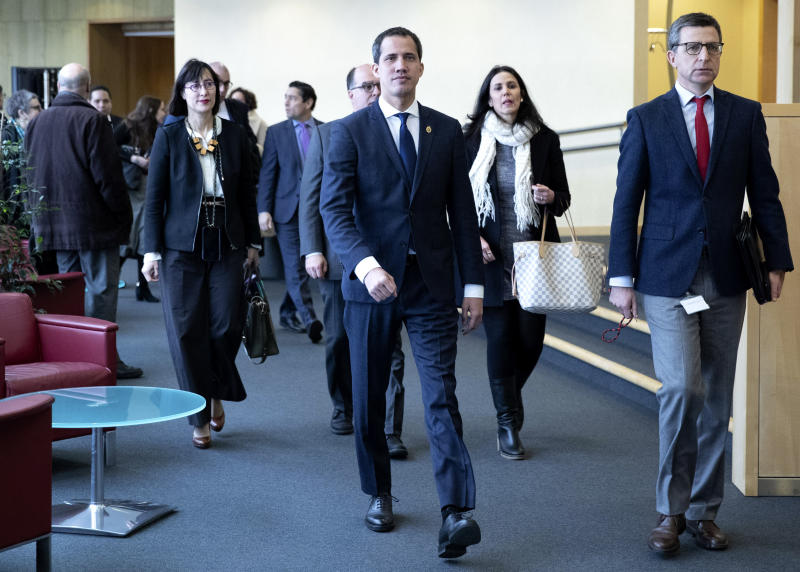 Leader of Venezuela's political opposition Juan Guaido, center, arrives prior to a meeting with European Union foreign policy chief Josep Borrell at EU headquarters on Wednesday, Jan. 22, 2020. (Aris Oikonomou, Pool Photo via AP)