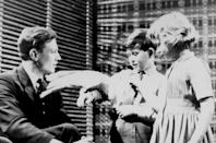 Prince Charles and Princess Anne on unofficial visit to the BBC Television Studios at Lime Grove, London. They had just watched the 'Studio E' children's programme in which Cocky the cockatoo had appeared, and met David Attenborough afterwards, in 1958. (PA Images)