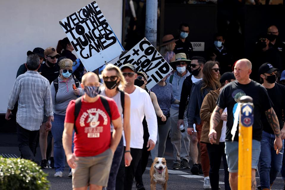 Protestors those with placards gather in Sydney on August 21, 2021, following calls for an anti-lockdown protest rally amid a fast-spreading coronavirus outbreak. (Photo by David Gray / AFP) (Photo by DAVID GRAY/AFP via Getty Images)