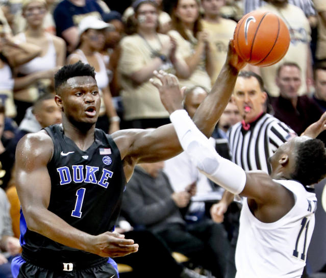 Duke's Zion Williamson (1) passes over Pittsburgh's Sidy N'Dir (11) during the second half of an NCAA college basketball game, Tuesday, Jan. 22, 2019, in Pittsburgh. Duke won 79-64. (AP Photo/Keith Srakocic)