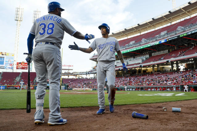Kansas City Royals' Adalberto Mondesi (27) celebrates with Jorge Bonifacio (38) after scoring on a double by Salvador Perez off Cincinnati Reds starting pitcher Cody Reed during the first inning of a baseball game, Wednesday, Sept. 26, 2018, in Cincinnati. (AP Photo/John Minchillo)