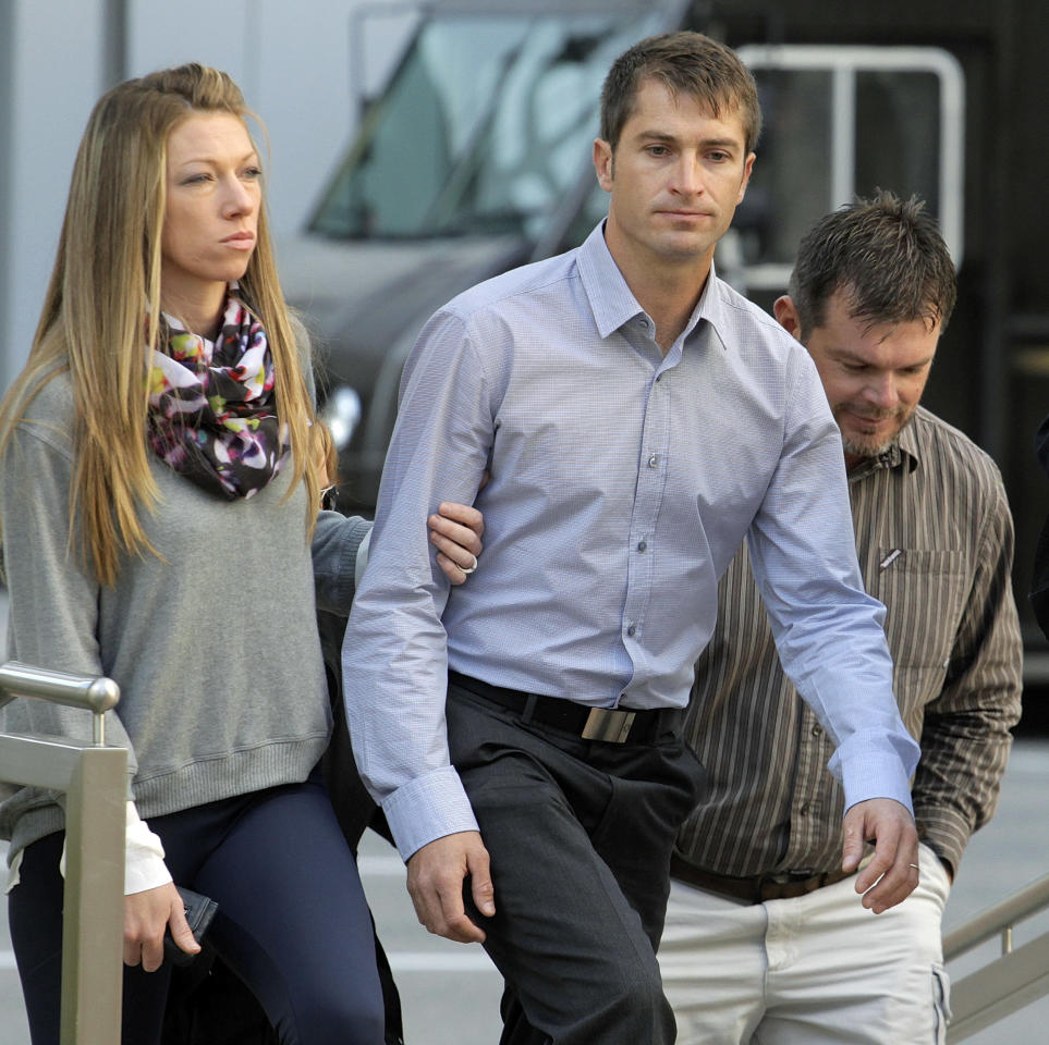 Eric Jensen, 37, right and Ryan Jensen, 33, center, brothers who owned and operated Jensen Farms, arrive at the federal courthouse in Denver, on Tuesday, Oct. 22, 2013, with family. The two Colorado farmers whose cantaloupes were tied to a 2011 listeria outbreak that killed 33 people, pleaded guilty on Tuesday to misdemeanor charges under a deal with federal prosecutors.(AP Photo/Ed Andrieski))