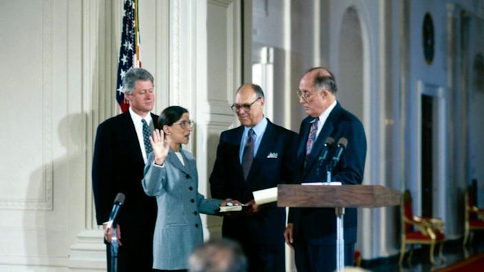 Marty Ginsburg holds the Bible for his wife as she is sworn in as Supreme Court Justice