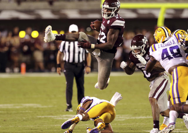 Mississippi State running back Aeris Williams (22) leaps over an LSU defender during the first half of their NCAA college football game against LSU in Starkville, Miss., Saturday, Sept. 16, 2017. Mississippi State won 37-7. (AP Photo/Jim Lyle)