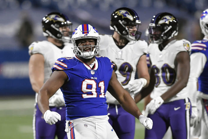 Buffalo Bills defensive tackle Ed Oliver (91) celebrates after stopping Baltimore Ravens' J.K. Dobbins in the backfield during the second half of an NFL divisional round football game Saturday, Jan. 16, 2021, in Orchard Park, N.Y. (AP Photo/Adrian Kraus)