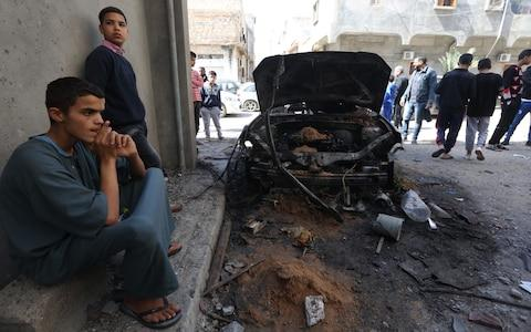 People inspect damage after rocket attacks at the Abu Salim neighborhood in Tripoli, Libya on April 17, 2019 - Credit: Hazem Turkia/Anadolu Agency/Getty Images