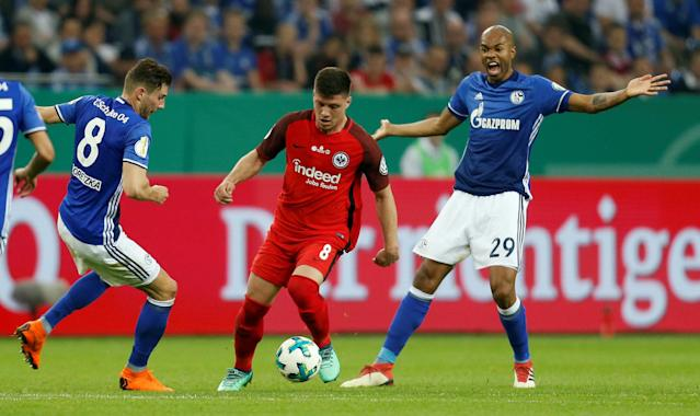 Soccer Football - DFB Cup - Schalke 04 vs Eintracht Frankfurt - Veltins-Arena, Gelsenkirchen, Germany - April 18, 2018 Eintracht Frankfurt's Luka Jovic in action with Schalke's Leon Goretzka and Naldo REUTERS/Leon Kuegeler DFB RULES PROHIBIT USE IN MMS SERVICES VIA HANDHELD DEVICES UNTIL TWO HOURS AFTER A MATCH AND ANY USAGE ON INTERNET OR ONLINE MEDIA SIMULATING VIDEO FOOTAGE DURING THE MATCH.