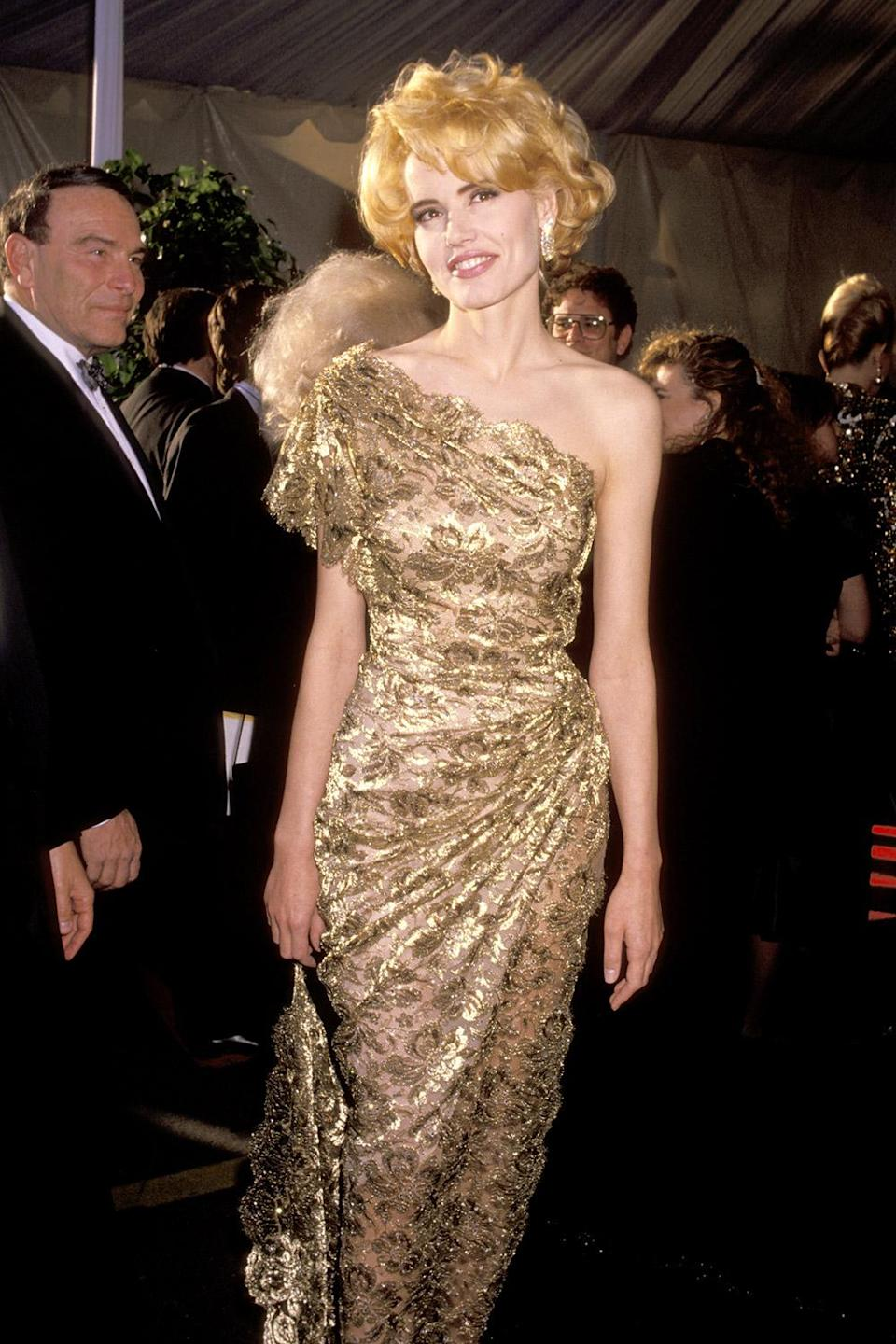 <p>Geena Davis took a cue from the Oscar statuette and wore gold for the 1991 Academy Awards. </p>