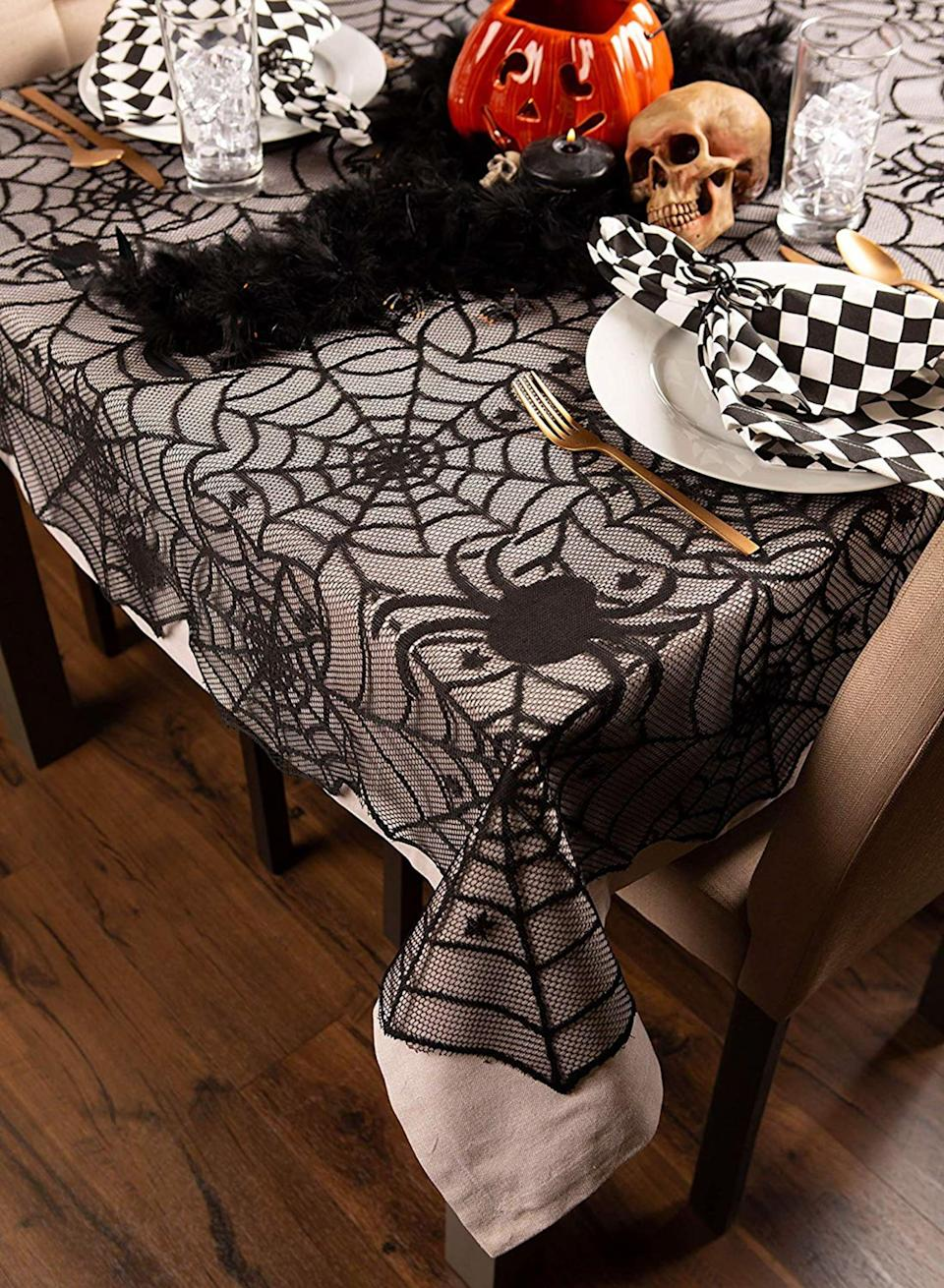 <p>Dress up a table in your room with spiders and cobwebs when you pick up the <span>Halloween Lace Tablecloth</span> ($27, originally $40) from Pier 1.</p>