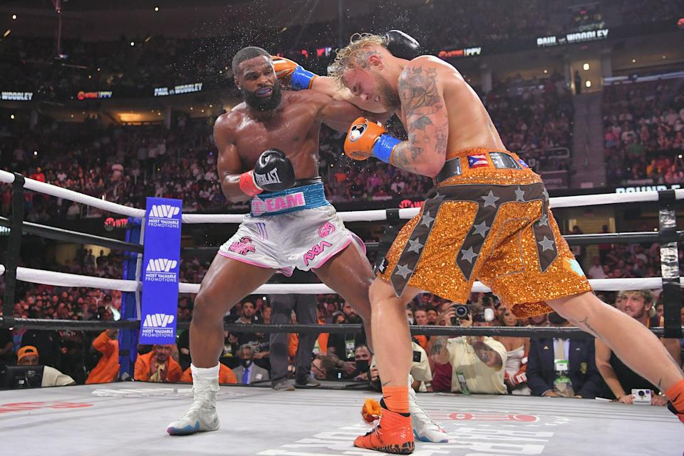 Jake Paul, right, fights Tyron Woodley in their cruiserweight bout on Sunday night.