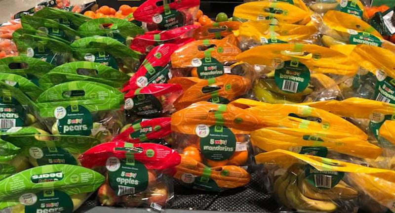 Photo from inside a Melbourne Woolworths store of mini fruit packaged inside plastic carry bags.