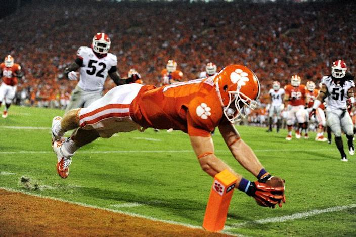 Clemson's Stanton Seckinger dives into the end zone for a fourth quarter touchdown against Georgia during the second half of an NCAA college football game, Saturday, Aug. 31, 2013, at Memorial Stadium in Clemson, S.C. (AP Photo/ Richard Shiro)