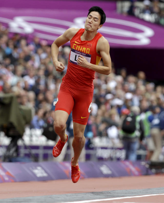 China's Liu Xiang hops on the track after falling in a men's 110-meter hurdles heat during the athletics in the Olympic Stadium at the 2012 Summer Olympics, London, Tuesday, Aug. 7, 2012. (AP Photo/Anja Niedringhaus)