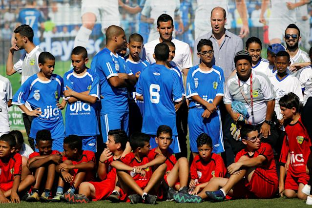 Britain's Prince William and Tomer Hemed, an Israeli professional footballer who plays as a striker for English Premier League club Brighton & Hove Albion pose for a photo with Jewish, Muslim and Christian children during a soccer event organized by The Equalizer and Peres Center for Peace in Jaffa, near Tel Aviv, Israel, June 26, 2018. REUTERS/Amir Cohen