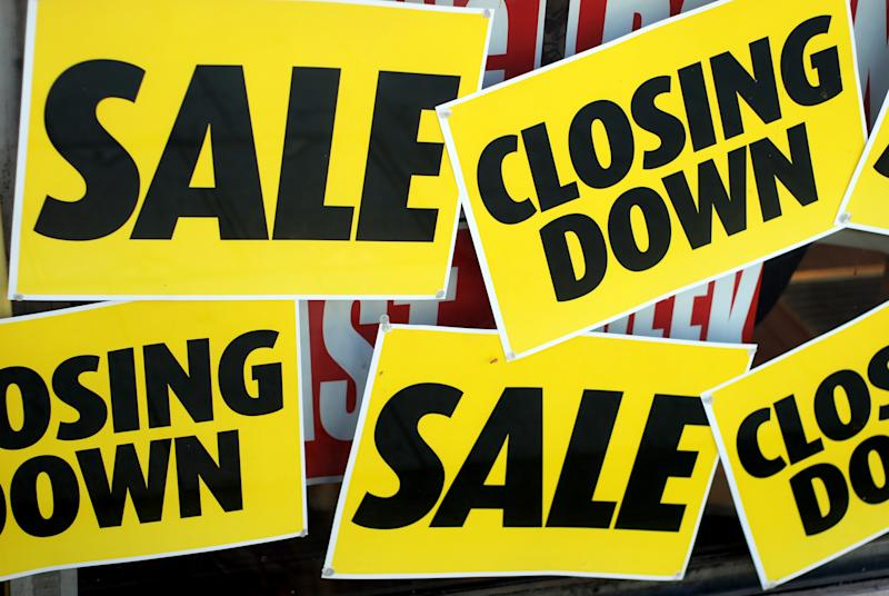 Sales, closing down signs. (PHOTO: Getty)