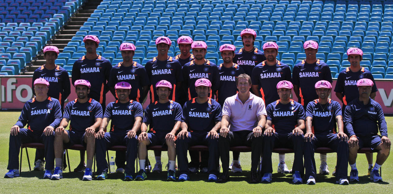 The Indian cricket team members along with former Australia cricket player Glenn McGrath, 4th right at front wear pink hats to support the McGrath Foundation in Sydney, Sunday, Jan. 1, 2012. India and Australia will play their second cricket test starting Jan. 3. (AP Photo/Rick Rycroft)