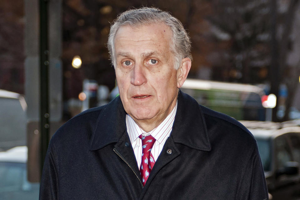 FILE - In this Nov. 30, 2012, file photo, former NFL commissioner Paul Tagliabue arrives at an attorney's office in Washington. Former NFL Commissioner Paul Tagliabue has made the Pro Football Hall of Fame in his fifth attempt. Tagliabue and former New York Giants general manager George Young made it as contributors. Ex-Dallas Cowboys safety Cliff Harris and former Cleveland receiver Mac Speedie completed the centennial class announced Wednesday, Jan. 15, 2020. The class of 10 senior candidates, three contributors and two coaches are part of the hall's celebration of the NFL's 100th season. (AP Photo/Cliff Owen, File)