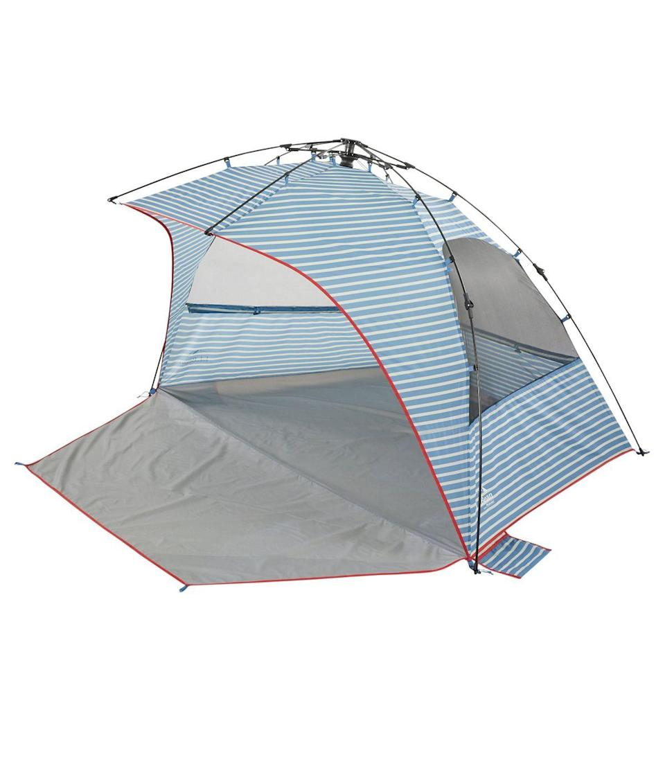 """We came for the  quaint nautical design of L.L. Bean's Sunbuster tent, and stayed for the glowing reviews. Happy customers praised the easy setup, thanks to the fancy-sounding """"Lightspeed"""" folding technology, enabling a user to erect the structure in seconds with the swiftness of opening an umbrella. It comes with stakes <em>and</em> sandbags for added stability, and rolls up into a carrying bag when not in use. <br> <br> <strong>L.L. Bean</strong> Sunbuster Folding Shelter, $, available at <a href=""""https://go.skimresources.com/?id=30283X879131&url=https%3A%2F%2Fwww.llbean.com%2Fllb%2Fshop%2F121281%3Fpage%3Dsunbuster-folding-shelter-print%26bc%3D29-915-1096-512954%26feat%3D512954-GN3%26csp%3Df%26attrValue_0%3DBayside%2520Blue%2520Stripe%26pos%3D1"""" rel=""""nofollow noopener"""" target=""""_blank"""" data-ylk=""""slk:L.L. Bean"""" class=""""link rapid-noclick-resp"""">L.L. Bean</a>"""