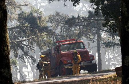 Firefighters prepare to embark on a mop-up operation during the Soberanes Fire in the mountains above Carmel Highlands, California, U.S. July 28, 2016. REUTERS/Michael Fiala