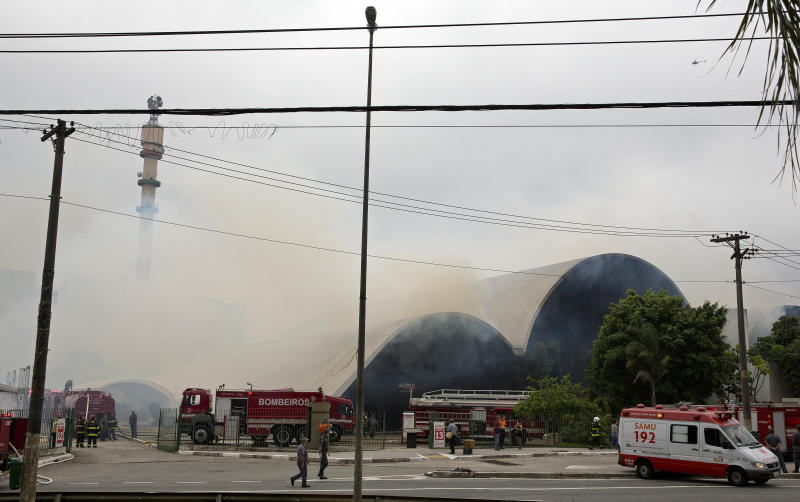 Firefighters work a fire that swept through the Simon Bolivar Auditorium at the Latin America Memorial in Sao Paulo, Brazil, Friday, Nov. 29, 2013. The fire department of Brazil's biggest city says a fire swept through the large auditorium that is part of the political, cultural and leisure complex designed by famed architect Oscar Niemeyer. No casualties were reported. Two firefighters had to be treated for smoke inhalation. (AP Photo/Andre Penner)