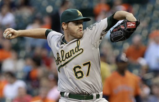 Oakland Athletics pitcher Dan Straily works against the Houston Astros in the first inning of a baseball game Friday, April 5, 2013, in Houston. (AP Photo/Pat Sullivan)