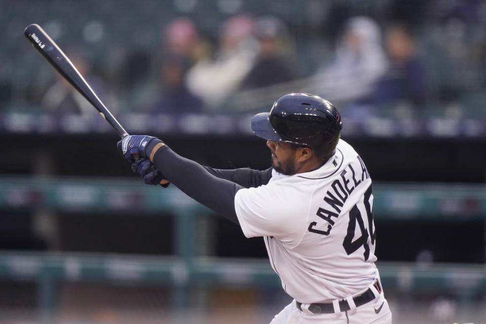 Detroit Tigers' Jeimer Candelario connects for an RBI single to right field during the third inning of a baseball game against the New York Yankees, Friday, May 28, 2021, in Detroit. (AP Photo/Carlos Osorio)