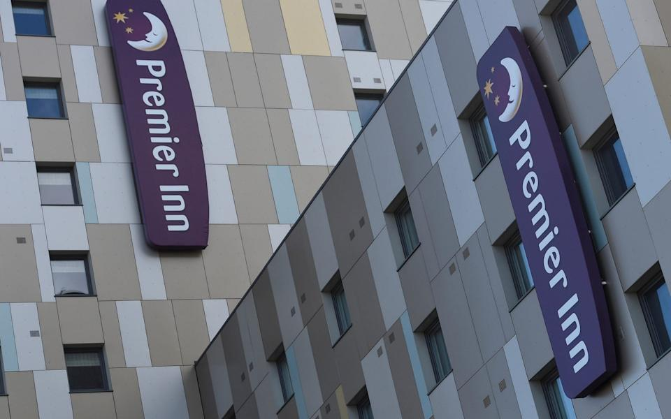 Signage for Premier Inn is seen on the outside of one of their hotels in London - Toby Melville/Reuters