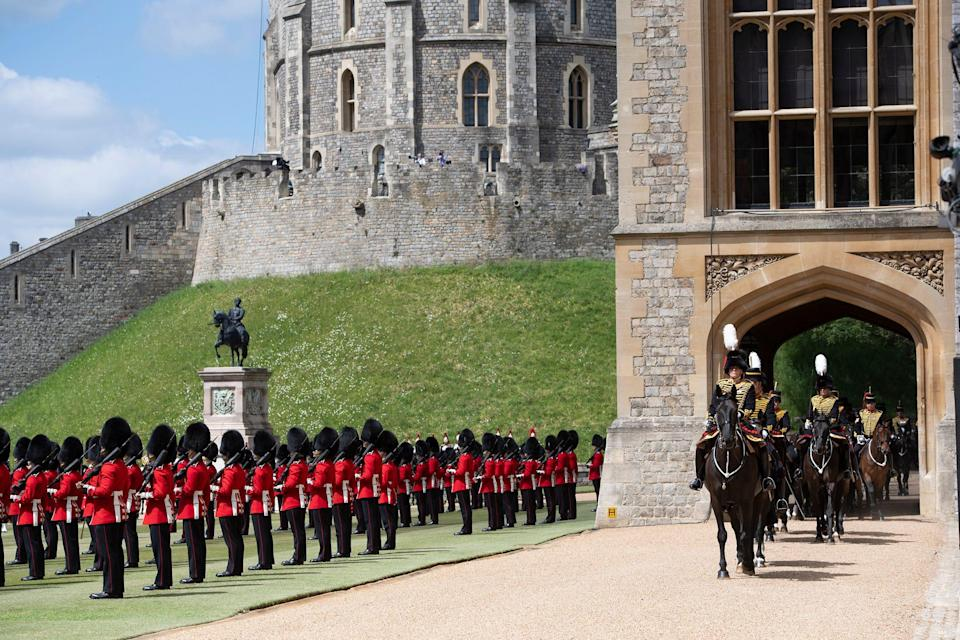 WINDSOR, ENGLAND - JUNE 12:  A general view as Queen Elizabeth II attends a military ceremony in the Quadrangle of Windsor Castle to mark her Official Birthday on June 12, 2020 at Windsor Castle on June 12, 2021 in Windsor, England. Trooping of the Colour has marked the Official Birthday of the Sovereign for over 260 years and it has been agreed once again that in line with government advice The Queen's Birthday Parade, also known as Trooping the Colour, will not go ahead in its traditional form. This years parade is formed by soldiers who have played an integral role in the NHS' COVID-19 response, as well as those who have been serving on military operations overseas. (Photo by Eddie Mulholland - WPA Pool/Getty Images)