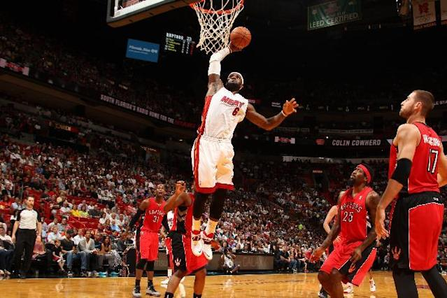 MIAMI, FL - March 31: LeBron James #6 of the Miami Heat goes up for the dunk against the Toronto Raptors at the American Airlines Arena in Miami, Florida on March 31 2014. (Photo by Issac Baldizon/NBAE via Getty Images)