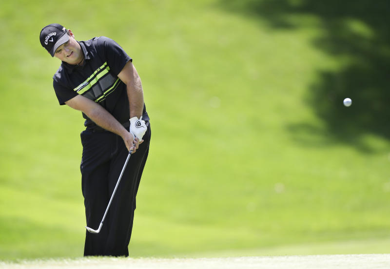 Patrick Reed chips onto the fifth green during the third round of the John Deere Classic golf tournament at TPC Deere Run, Saturday, July 13, 2013, in Silvis, Ill. (AP Photo/Charlie Neibergall)