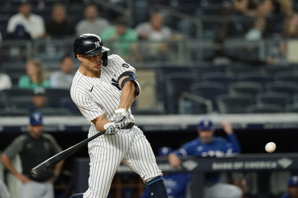 New York Yankees' Giancarlo Stanton hits a home run during the third inning of a baseball game against the Texas Rangers Tuesday, Sept. 21, 2021, in New York. (AP Photo/Frank Franklin II)