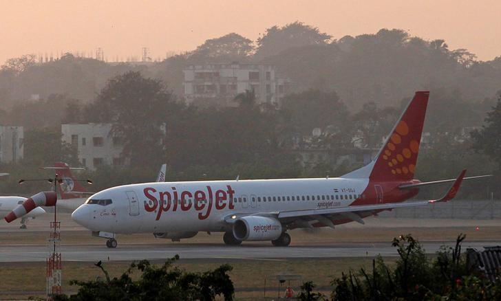 FILE PHOTO: A SpiceJet aircraft taxis on the tarmac after landing at Chhatrapati Shivaji international airport in Mumbai