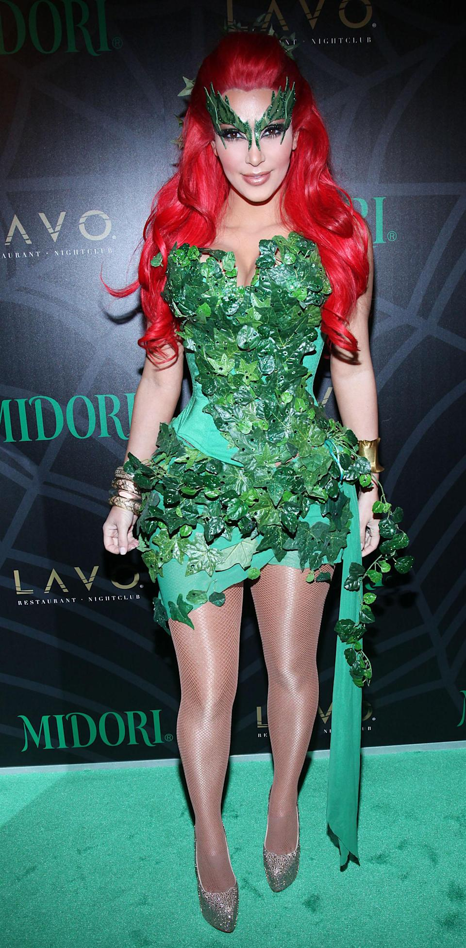 <p>Back in 2011, Kim Kardashian attended the Midori Green Halloween costume party in New York. For the event, she donned a green leaf-emblazoned outfit. <em>[Photo: Getty]</em> </p>